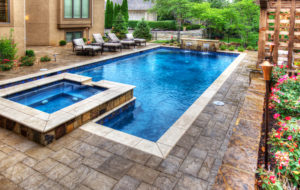 A lap pool and spa in Leawood Kansas by Backyard by Design KC