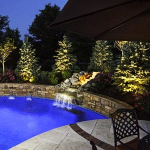 A-beautiful--blue-pool-and-lightscape-by-Backyard-by-Design-Kansas-City