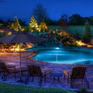 A-beautiful-landscape-pool-and-lightscape-by-Backyard-by-Design-Kansas-City