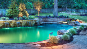 A-beautiful-pool-and-lightscape-by-Backyard-by-Design-Kansas-City