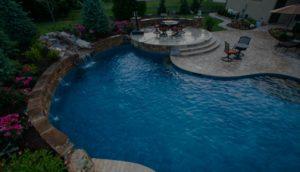 A beautiful backyard pool designed by backyard by design Kansas City