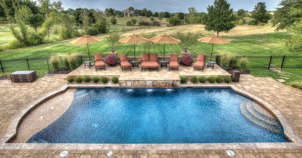 A-traditional-pool-with-fountains-from-Backyard-by-Design-Kansas-City