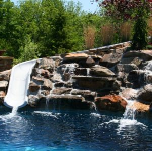 A waterfall and water slide from Backyard by Design Kansas City