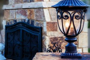 Light by stonework fireplace