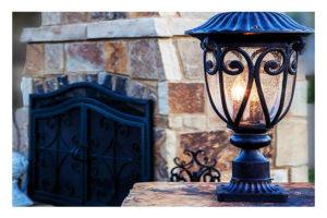 Light by stonework fireplace