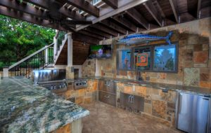 Outdoor Kitchen in a pool house by Backyard by Design KC