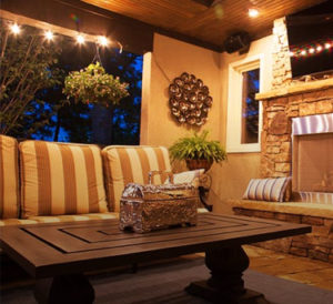 Outdoor living room with fireplace designed by Backyard by Design