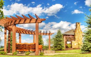 A pergola with firepit by KC builders Backyard by Design