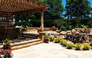 An arbor with waterfall built by KC builders Backyard by Design