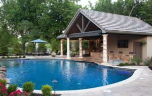 Pool house build by backyard by design KC
