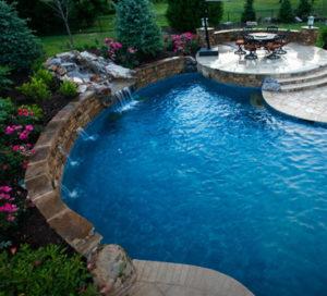 A custom backyard pool with waterfall