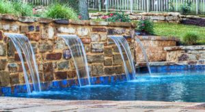 Water-feature-in-pool-from-Backyard-by-Design-KC
