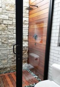 Backyard by design custom outdoor pool house cabana bathroom with an outdoor shower