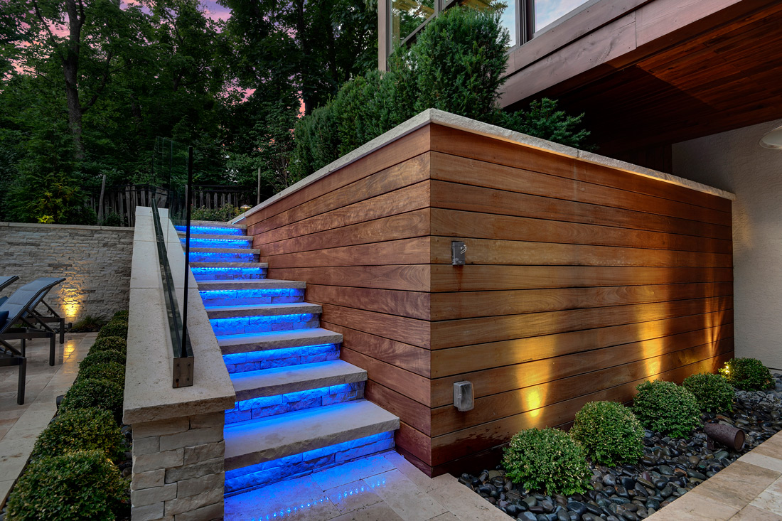 Backyard by design patio stairs and lighting
