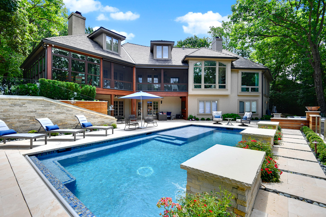Backyard with pool, landscaping and patio furniture