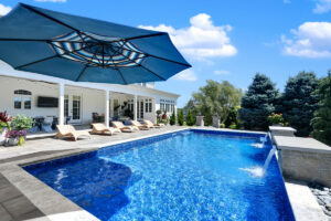 Backyard by design luxurious pool, landscaping and furniture