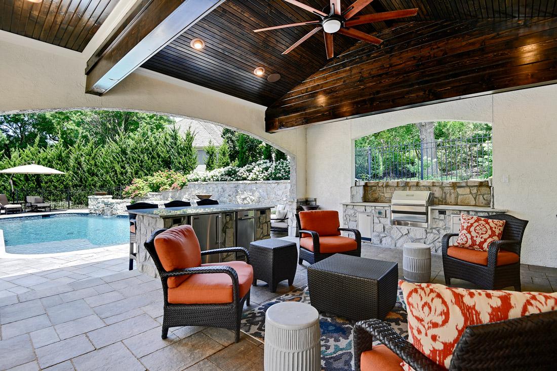 Backyard by design patio enclosure, bar and furniture